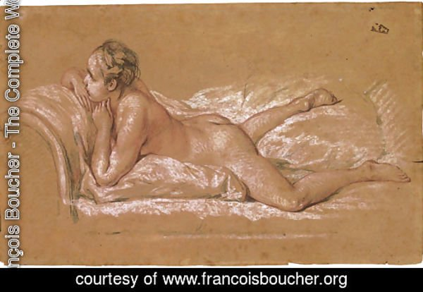 A female nude reclining on a chaise-longue